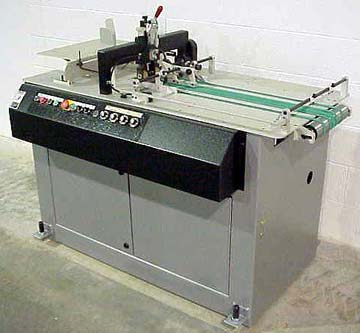 Kirk Rudy shuttle feeder for labeling systems